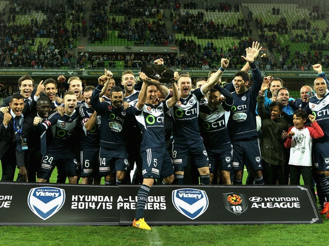 Melbourne Victory players celebrate after winning the premiers plate during the round 27 A-League match between the Melbourne Victory and Central Coast Mariners at AAMI Park on April 26, 2015