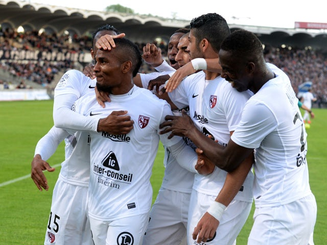 Metz's players celebrate after their Tunisian midfielder Ferjani Sassi scored a goal during the French L1 football match between Bordeaux (FCGB) and Metz (FCM) on April 25, 2015