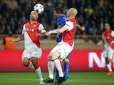 Juventus' forward from Argentina Carlos Tevez vies with Monaco's Tunisian defender Aymen Abdennour during the UEFA Champions League quarter final second leg football match AS Monaco vs Juventus FC on April 22, 2015