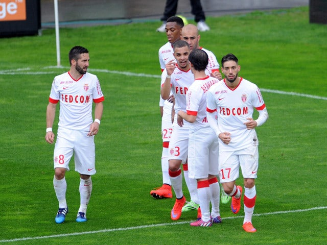 Monaco's Belgian midfielder Yannick Ferreira Carrasco celebrates with teammates after scoring a goal during the French L1 football match between Lens and Monaco at Licorne stadium in Amiens, northern France, on April 26, 2015