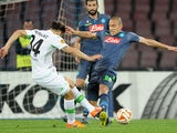 Napoli's player Gokhan Inler vies with VfL Wolfsburg player Ricardo Rodriguez during the UEFA Europa League quarter-final second leg match between SSC Napoli and VfL Wolfsburg on April 23, 2015