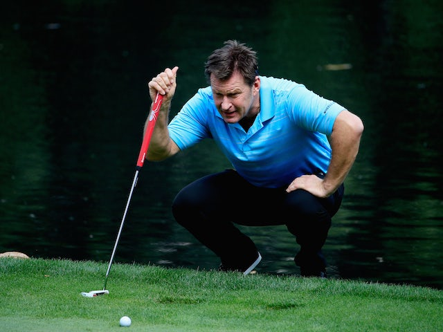 Sir Nick Faldo of England lines up a putt during the Par 3 Contest prior to the start of the 2015 Masters Tournament at Augusta National Golf Club on April 8, 2015