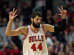 Bulls edge out Cavs in season opener