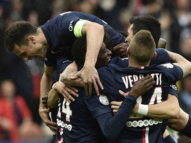 Paris Saint-Germain's Brazilian defender Maxwell is congratuled by teammates after scoring a goal during the French L1 football match between Paris Saint-Germain and Lille on April 25, 2015