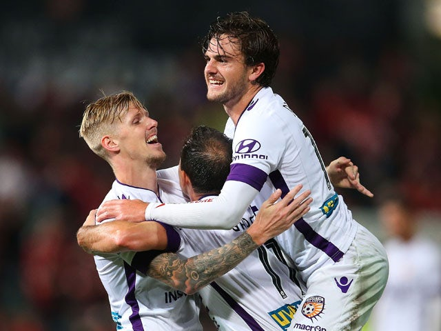 Andrew Keogh of the Glory celebrates with team mates Joshua Risdon and Richard Garcia after scoring a goal during the round 27 A-League match between the Western Sydney Wanderers and the Perth Glory at Pirtek Stadium on April 25, 2015