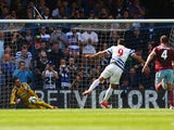 Adrian of West Ham saves a penalty from Charlie Austin of QPR during the Barclays Premier League match between Queens Park Rangers and West Ham United at Loftus Road on April 25, 2015