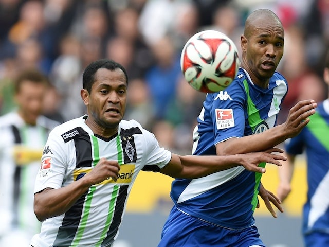 Moenchengladbach's Brazilian midfielder Raffael (L) and Wolfsburg's Brazilian defender Naldo vie for the ball during the German first division Bundesliga football match between Borussia Moenchengladbach and VfL Wolfsburg at the Borussia Park Stadium in Mo