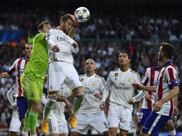 Real Madrid's goalkeeper Iker Casillas punches the ball during the UEFA Champions League quarter-finals second leg football match Real Madrid CF vs Club Atletico de Madrid at the Santiago Bernabeu stadium in Madrid on April 22, 2015