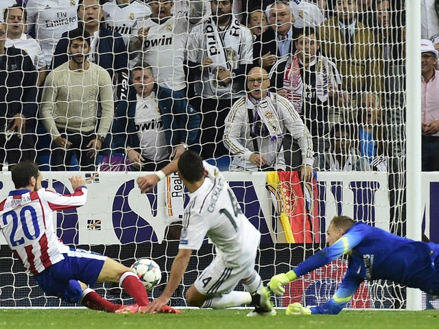 Real Madrid's Mexican forward Javier Hernandez shoots to score a goal during the UEFA Champions League quarter-finals second leg football match Real Madrid CF vs Club Atletico de Madrid at the Santiago Bernabeu stadium in Madrid on April 22, 2015