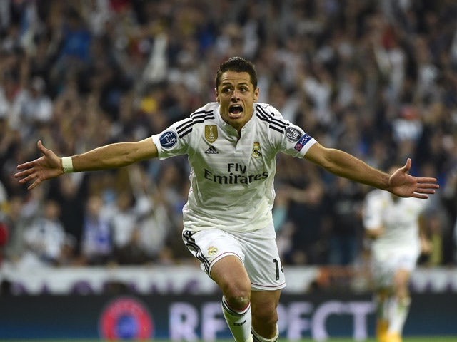 Real Madrid's Mexican forward Javier Hernandez celebrates after scoring a goal during the UEFA Champions League quarter-finals second leg football match Real Madrid CF vs Club Atletico de Madrid at the Santiago Bernabeu stadium in Madrid on April 22, 2015