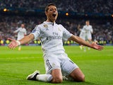Javier Hernandez of Real Madrid CF celebrates as he scores their first goal during the UEFA Champions League quarter-final second leg match between Real Madrid CF and Club Atletico de Madrid at Bernabeu on April 22, 2015