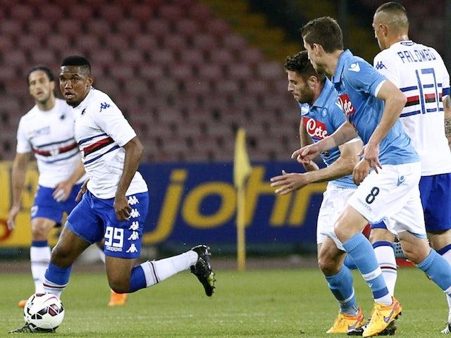 Sampdoria's Cameroonian forward Samuel Eto'o (L) runs with the ball during the Italian Serie A football match between SSC Napoli and UC Sampdoria on April 26, 2015