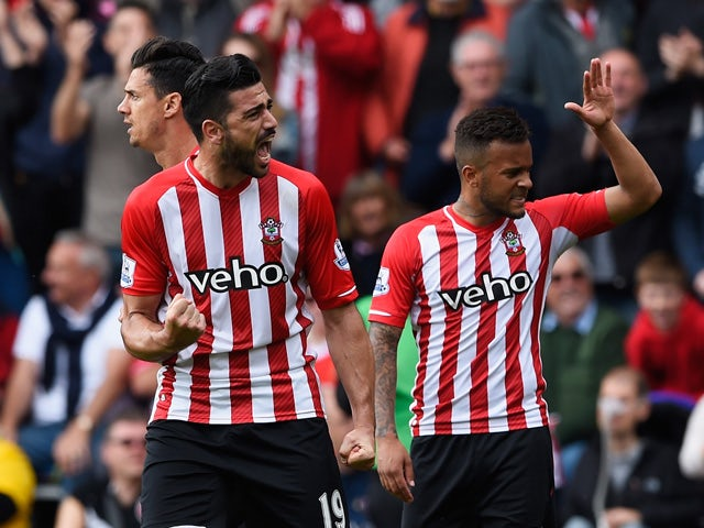 Graziano Pelle of Southampton celebrates scoring the opening goal with Ryan Bertrand of Southampton during the Barclays Premier League match between Southampton and Tottenham Hotspur at St Mary's Stadium on April 25, 2015