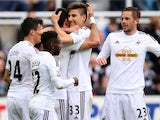 Swansea City's Portuguese striker Nelson Oliveira celebrates with teammates after scoring during the English Premier League football match between Newcastle and Swansea at St. James' Park stadium in Newcastle, north east England on April 25, 2015