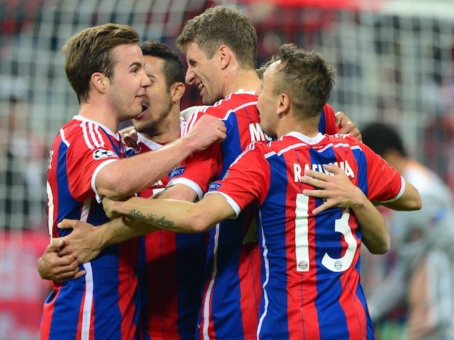 Bayern Munich's midfielder Thomas Mueller (2nd R) celebrates scoring with his team-mates during the UEFA Champions League second-leg quarter-final football match Bayern Munich v FC Porto in Munich, southern Germany on April 21, 2015