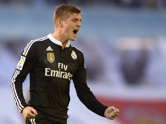 Real Madrid's German midfielder Toni Kroos celebrates after scoring a goal during the Spanish league football match Celta Vigo vs Real Madrid CF at the Balaidos stadium in Vigo on April 26, 2015