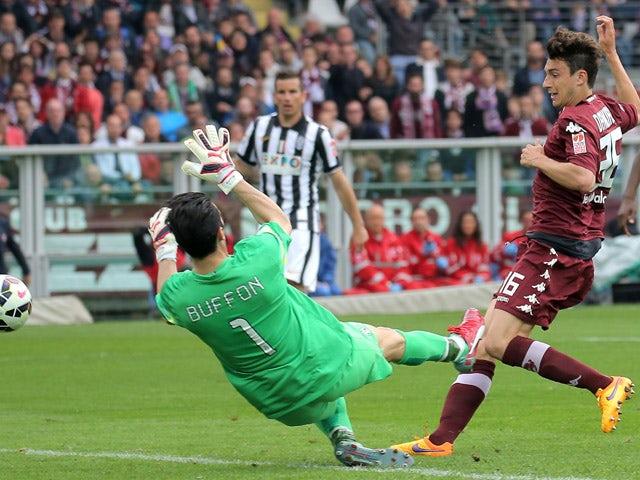 Torino's defender Matteo Darmian scores past Juventus' goalkpeeper Gianluigi Buffon during the Italian Serie A football match Torino vs Juventus on April 26, 2015