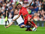 Craig Dawson of West Brom tackles Raheem Sterling of Liverpool during the Barclays Premier League match between West Bromwich Albion and Liverpool at The Hawthorns on April 25, 2015