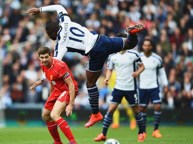 Victor Anichebe of West Brom climbs above Steven Gerrard of Liverpool during the Barclays Premier League match between West Bromwich Albion and Liverpool at The Hawthorns on April 25, 2015