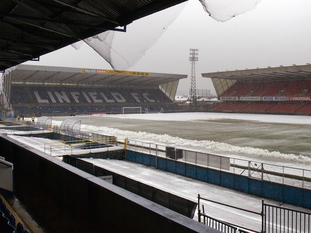 Snow covers Windsor Park pitch and stadium in Belfast, Northern Ireland, on March 22, 2013