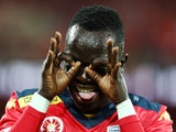 Awer Mabil of United celebrates after scoring a goal during the A-League Elimination Final match between Adelaide United and Brisbane Roar at Adelaide Oval on May 1, 2015