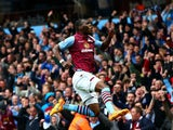 Christian Benteke of Aston Villa celebrates scoring his team's second goal during the Barclays Premier League match between Aston Villa and Everton at Villa Park on May 2, 2015