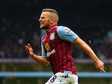 Tom Cleverley of Aston Villa celebrates his team's third goal during the Barclays Premier League match between Aston Villa and Everton at Villa Park on May 2, 2015