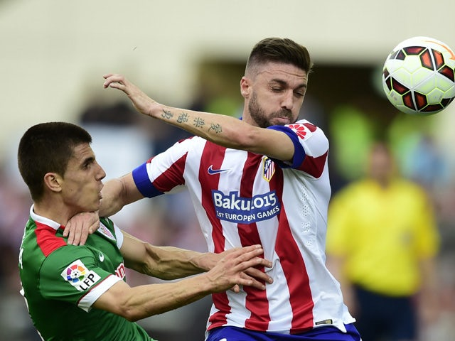 Atletico Madrid's Brazilian defender Guilherme Siqueira vies with Athletic Bilbao's defender Unai Bustinza during the Spanish league football match Club Atletico de Madrid vs Athletic Club Bilbao at the Vicente Calderon stadium in Madrid on May 2, 2015