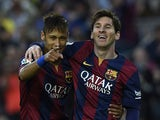 Barcelona's Brazilian forward Neymar da Silva Santos Junior (L) and Barcelona's Argentinian forward Lionel Messi (R) celebrate after scoring a goal during the Spanish league football match FC Barcelona vs Getafe at the Camp Nou stadium in Barcelona on Apr