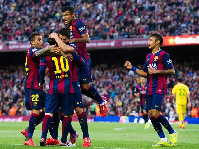 Luis Suarez celebrates after scoring his team's second goal during the La Liga match between FC Barcelona and Getafe CF at Camp Nou on April 28, 2015