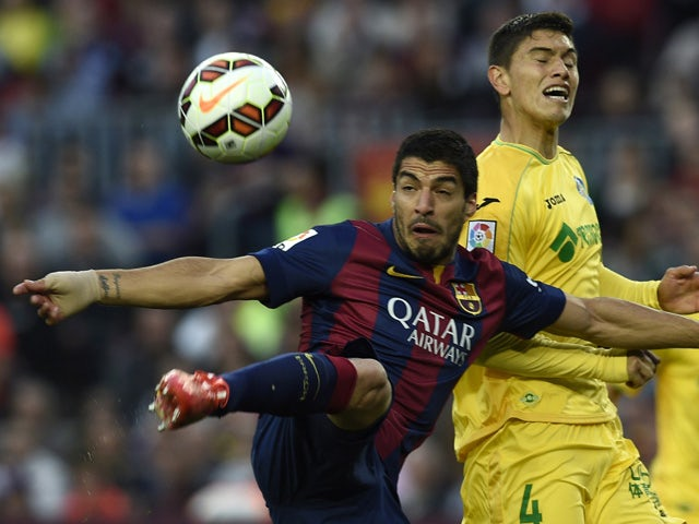 Barcelona's Uruguayan forward Luis Suarez scores a goal during the Spanish league football match FC Barcelona vs Getafe at the Camp Nou stadium in Barcelona on April 28, 2015
