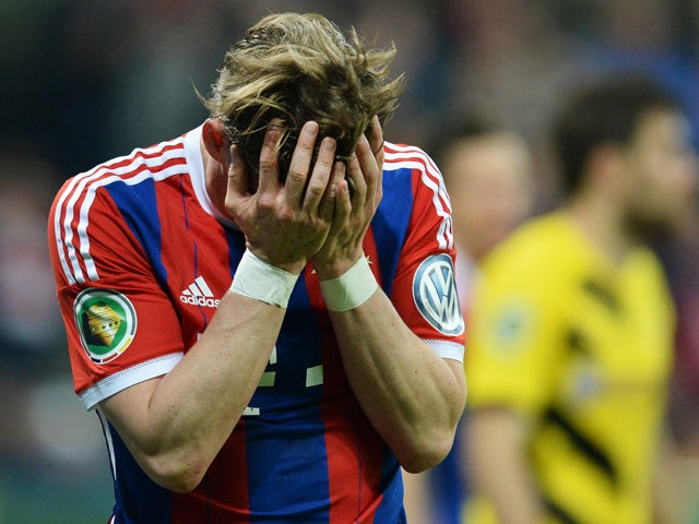 Bayern Munich's midfielder Bastian Schweinsteiger reacts after failling to score from his header during the German Cup DFB Pokal semi-final football match FC Bayern Munich v Borussia Dortmund in Munich, southern Germany, on April 28, 2015