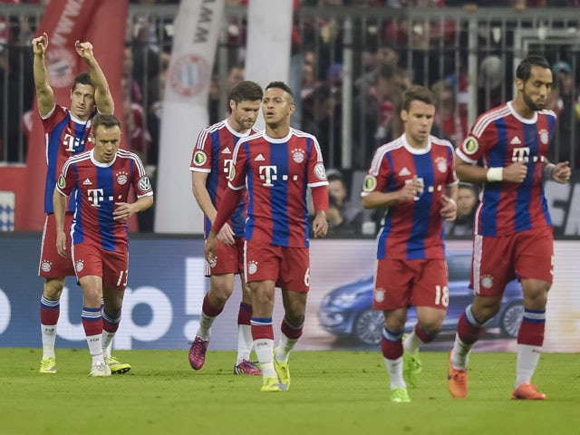 Bayern Munich's Polish striker Robert Lewandowski celebrates scoring with his team-mates during the German Cup DFB Pokal semi-final football match FC Bayern Munich v Borussia Dortmund in Munich, southern Germany, on April 28, 2015
