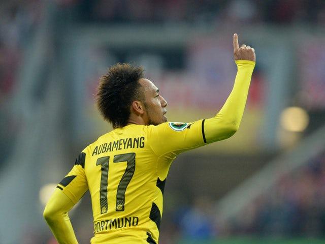 Dortmund's Gabonese midfielder Pierre-Emerick Aubameyang celebrates scoring the equalizer during the German Cup DFB Pokal semi-final football match FC Bayern Munich v Borussia Dortmund in Munich, southern Germany, on April 28, 2015