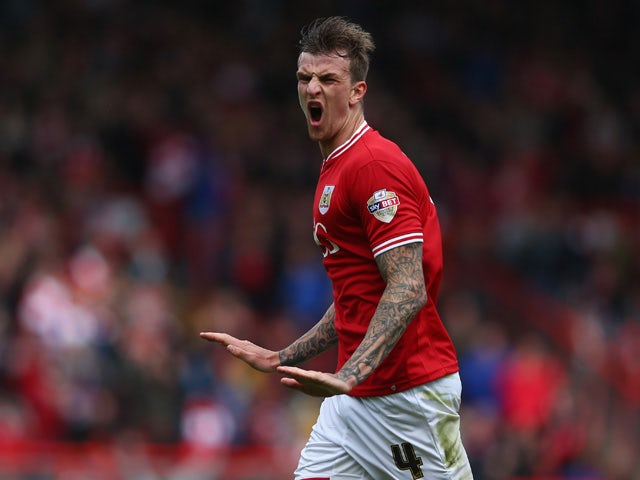 Aden Flint of Bristol City celebrates scoring the first goal for Bristol City during the Sky Bet League One match between Bristol City and Walsall at Ashton Gate on May 3, 2015