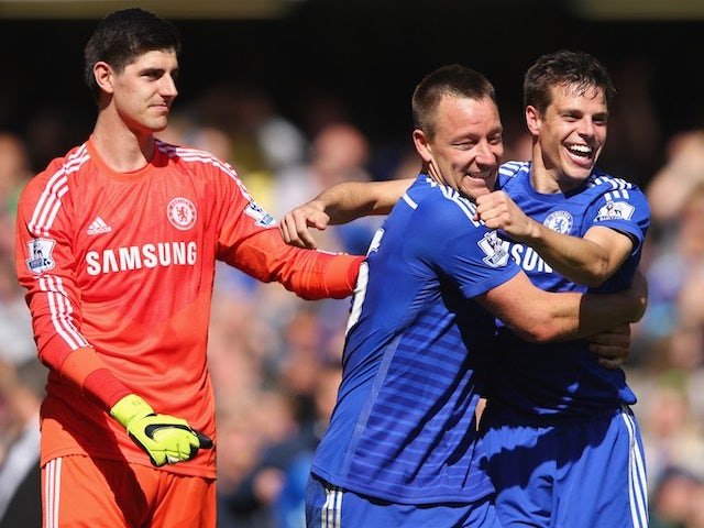 Chelsea players Thibaut Courtois, John Terry and Cesar Azpilicueta celebrate after the Blues secured the Premier League title on May 3, 2015