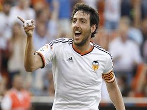 Valencia's midfielder Dani Parejo celebrates after scoring during the Spanish league football match Valencia CF vs SD Eibar at the Mestalla stadium in Valencia on May 3, 2015
