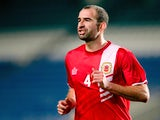 Danny Higginbotham of Gibraltar in action during the international friendly match between Gibraltar and Slovakia at Estadio do Alagarve on November 19, 2013
