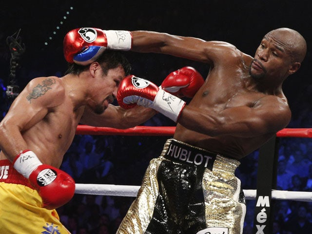 US boxer Floyd Mayweather Jr., and Manny Pacquiao of the Philippines fight during their welterweight unification boxing bout at the MGM Grand Garden Arena in Las Vegas, Nevada on May 2, 2015