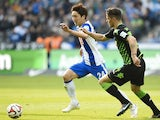 Hertha's Japanese midfielder Genki Haraguchi (L) and Moenchengladbach's Swiss midfielder Granit Xhaka vie for the ball during the German first division Bundesliga football match between Hertha BSC Berlin and Borussia Moenchengladbach at the Olympic Stadiu