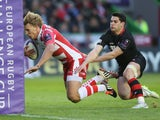 Billy Twelvetrees of Gloucester moves away from Sam Hidalgo-Clyne to score a try during the European Rugby Challenge Cup Final match between Edinburgh and Gloucester at Twickenham Stoop on May 1, 2015