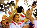 Captain Billy Twelvetrees of Gloucester lifts the trophy following his team's victory during the European Rugby Challenge Cup Final match between Edinburgh and Gloucester at the Twickenham Stoop on May 1, 2015