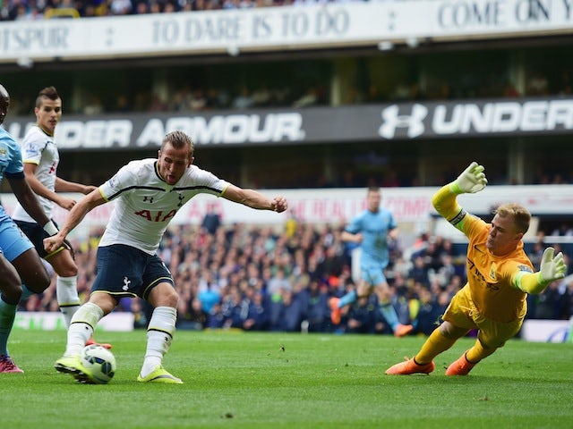 Harry Kane of Spurs is foiled by goalkeeper Joe Hart of Manchester City during the Barclays Premier League match between Tottenham Hotspur and Manchester City at White Hart Lane on May 3, 2015
