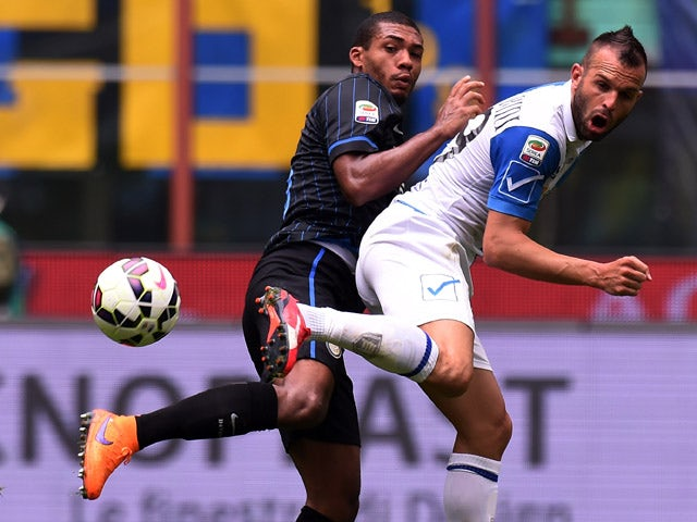 Juan Jesus of Internazionale Milano and Riccardo Meggiorini of Chievo Verona compete for the ball during the Serie A match between FC Internazionale Milano and AC Chievo Verona at Stadio Giuseppe Meazza on May 3, 2015