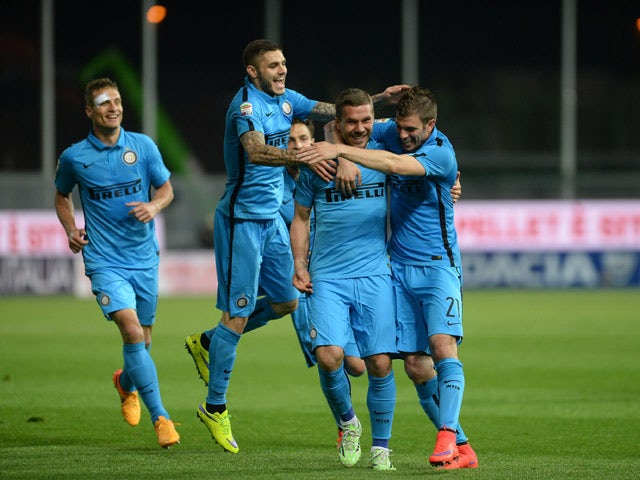 Lukas Podolski of Internazionale Milano celebrates after scoring his team's second goal during the Serie A match between Udinese Calcio and FC Internazionale Milano at Stadio Friuli on April 28, 2015