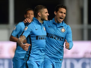 Mauro Icardi of Internazionale celebrates after scoring his team's opening goal from the penalty spot during the Serie A match between Udinese Calcio and FC Internazionale Milano at Stadio Friuli on April 28, 2015