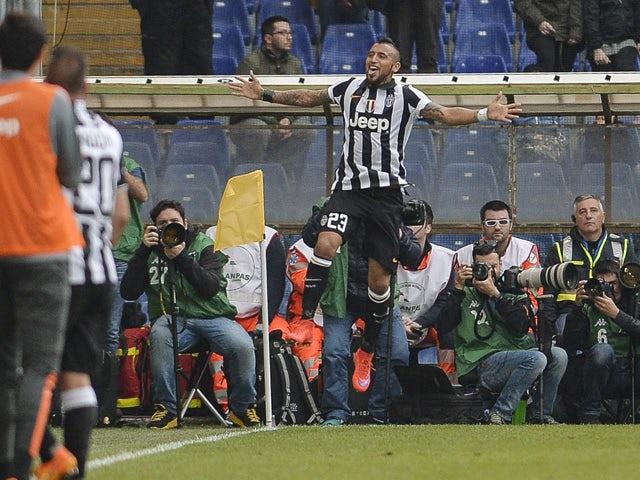 Juventus' Chilean midfielder Arturo Vidal celebrates after scoring a goal during the Italian Serie A football match Sampdoria vs Juventus on May 2, 2015