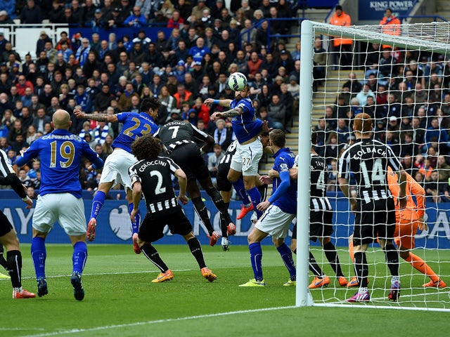 Leonardo Ulloa of Leicester City heads the opening goal during the Barclays Premier League match between Leicester City and Newcastle United at The King Power Stadium on May 2, 2015
