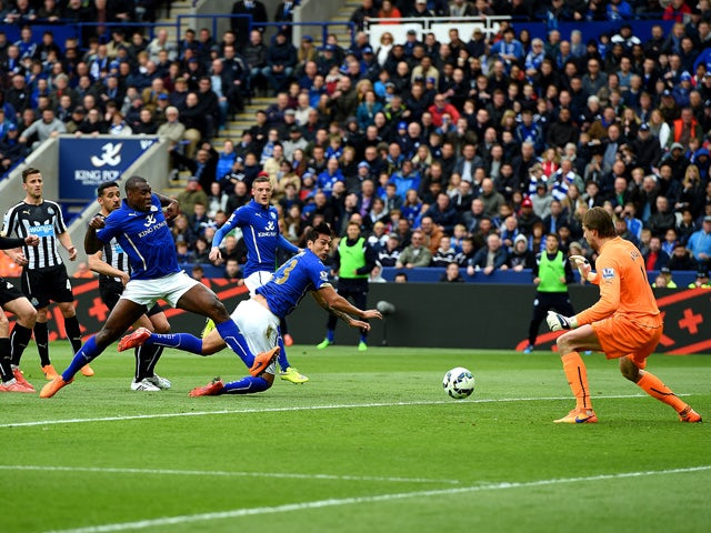 Wes Morgan of Leicester City scores his team's second goal during the Barclays Premier League match between Leicester City and Newcastle United at The King Power Stadium on May 2, 2015