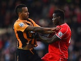 Tom Huddlestone of Hull City and Mario Balotelli of Liverpool clash during the Barclays Premier League match between Hull City and Liverpool at KC Stadium on April 28, 2015